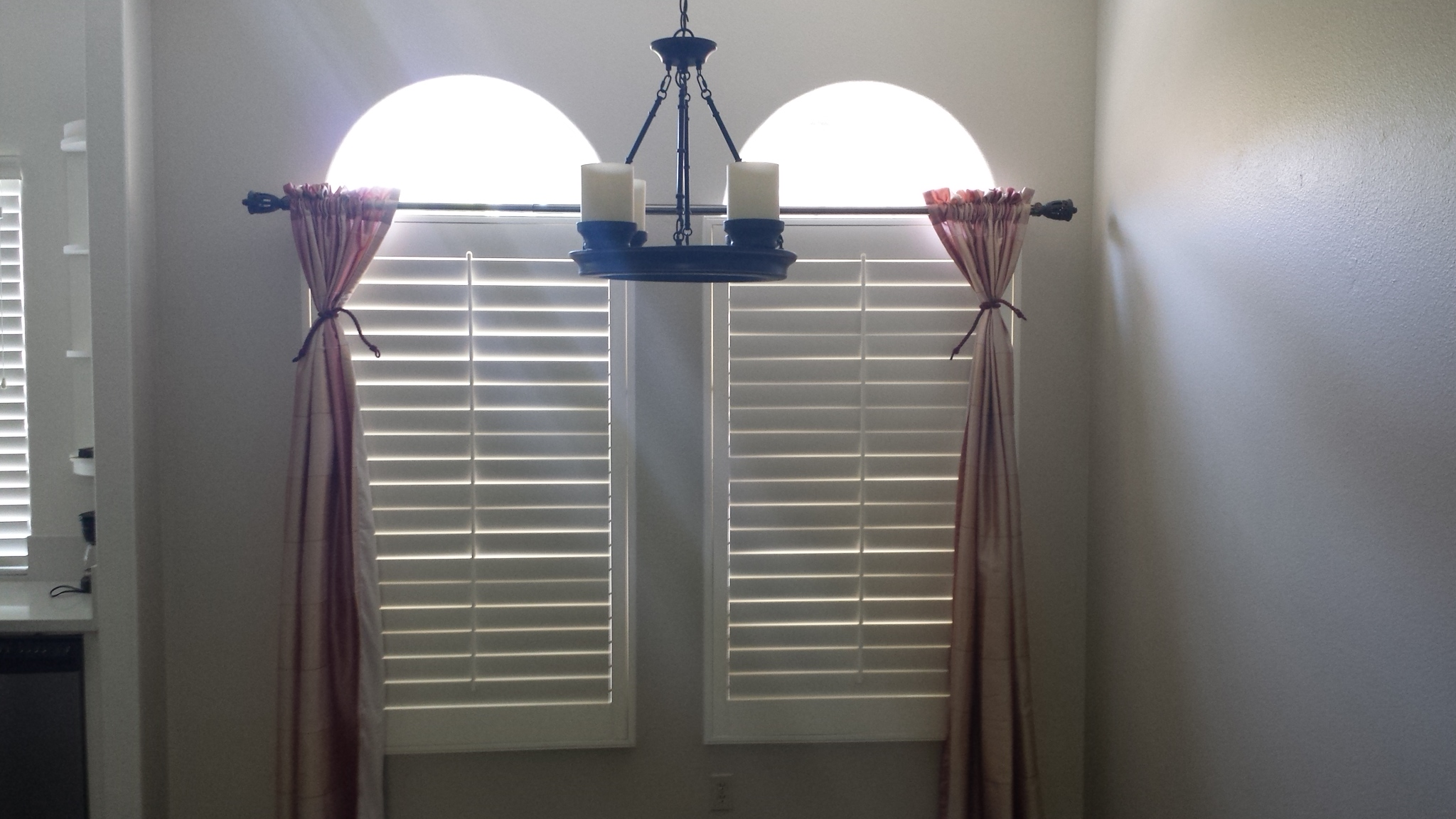 Drapes over shutters